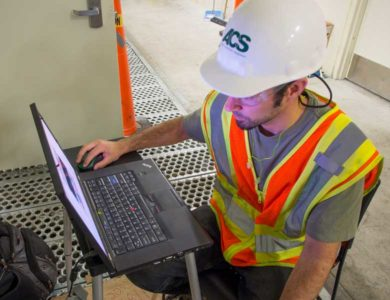 An ACS employee helps to commission a manufacturing plant that was recently constructed by them